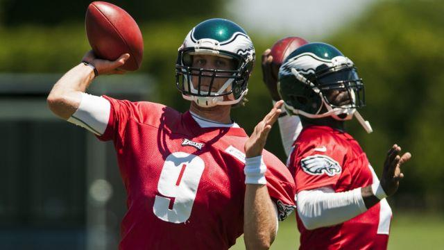 QBs Nick Foles and Michael Vick are locked in a tight battle for the starting job.
